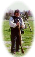 Host historian Charlie Tarbox shows guests how to fire a Civil War musket.