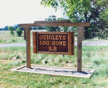 Quigley's Log Home B&B front sign