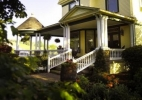 The Hasseman House is a cheerful yellow landmark, welcoming guests who delight its Victorian charms
