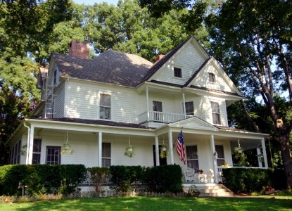 Historic estate nestled on a hill overlooking the picturesque town of Waynesville and the surrounding mountains.