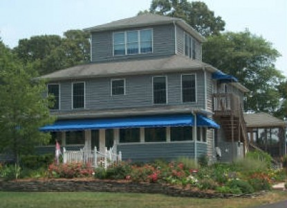 Bed and Breakfast Resort on 8 secluded acres in Lewes Delaware - water view and close to beaches. PET FRIENDLY.