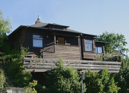 Craftsman-Style Redwood Bungalow, situated on a spacious corner lot, on a quiet residential street in North Berkeley.