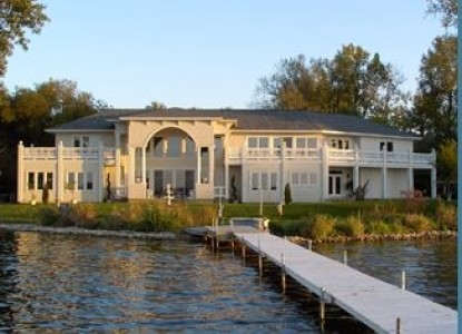 Magnificent home on the shores of Winona Lake. Enjoy breathtaking views from every room or watch the sunset on your balcony.