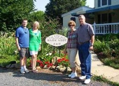 The Mark Addy Bed & Breakfast Inn people in front of sign