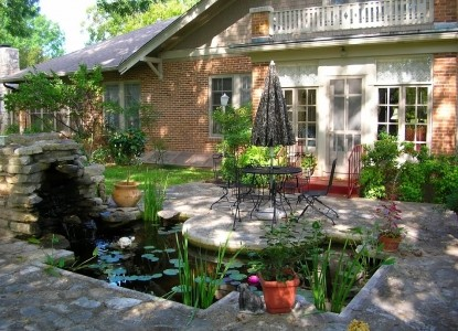 Magnolia House Bed & Breakfast fishpond and patio
