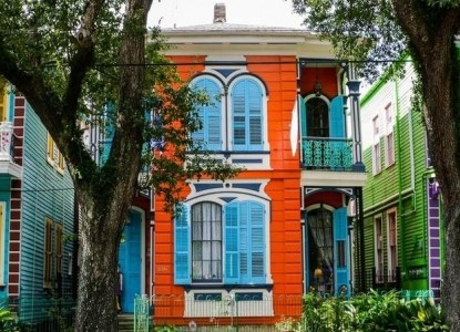 A colorful landmark inn located in the middle of one of the most beautiful streets in New Orleans.
