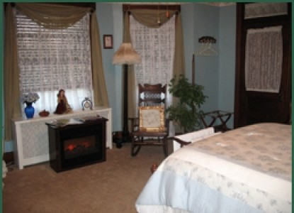 Our guests may enjoy sitting in our parlor with its working fireplace to watch TV, read or play the