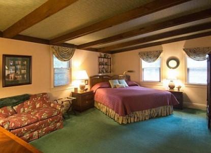 Cottage bedroom at Pinecrest Cottage and Gardens