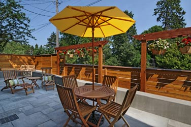 Chelsea Station Inn Bed & Breakfast patio with yellow umbrella