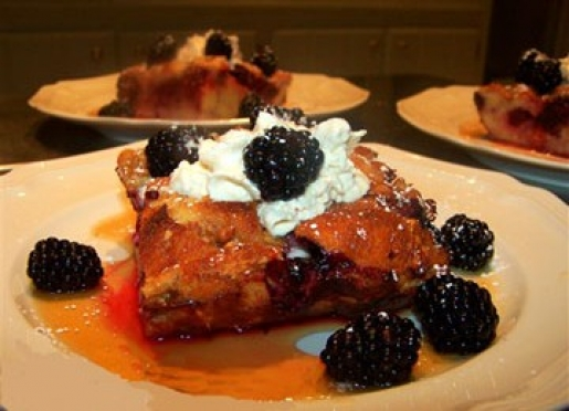 Blackberry Breakfast Pudding w/warmed Maple Syrup and sausages, Amaretto French Toast w/ fresh fruit