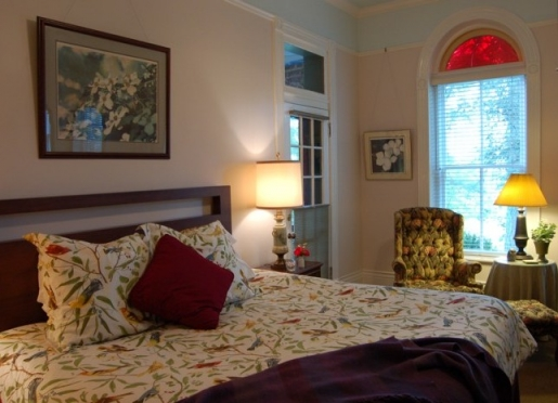 Room 1 - Mountain Sunrise Romance, with fireplaces, whirlpool, and king bed.