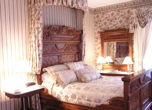 Lady Katherine room with antique burl walnut bed and dresser.