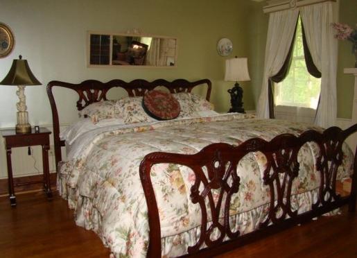 Serenity bedroom at Breeden Inns' Retreat on Main