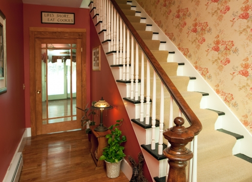 dining room area is decorated with lovely Waverly wallcoverings and authentic hardwood flooring