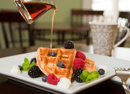 Warm Belgian Waffles & Fresh Fruit drizzled with Bourbon infused pure Maine Maple Syrup