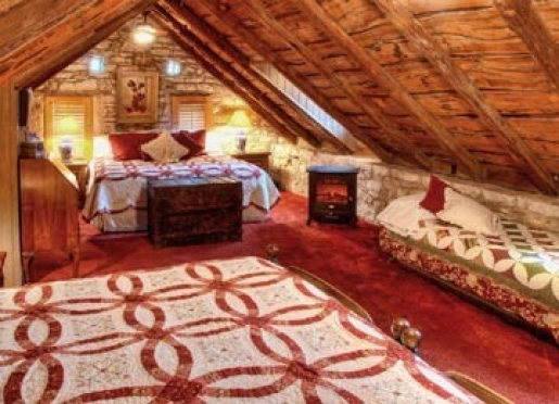 Katherine's Attic room is a large upstairs room w/2 kings and 1 twin beds and shower/Jacuzzi bath.