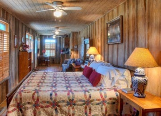 The Porch room is a downstairs room, has 1 king & 1 queen sofa bed, a shower bath & kitchenette.