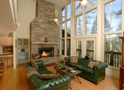The stacked stone fireplace in this private guest house goes all the way to the ceiling.