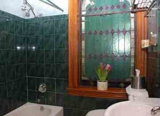 Copper Room's Traditional Bathroom