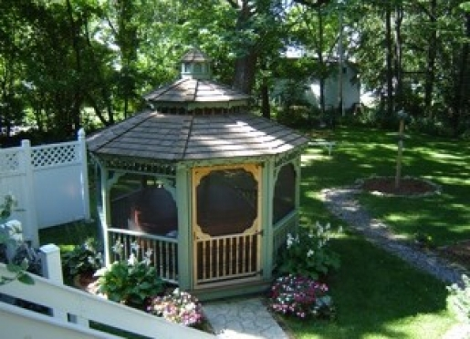 The garden screened gazebo encloses the hot tub.