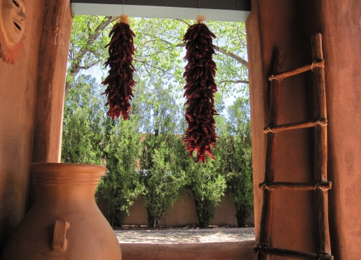 Chili ristras hang warmly welcoming Pueblo Bonito Inn vistors to Santa Fe!