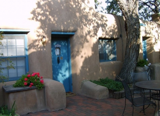 Foot thick adobe walls with private grounds, mature landscaping and quiet ambiance.