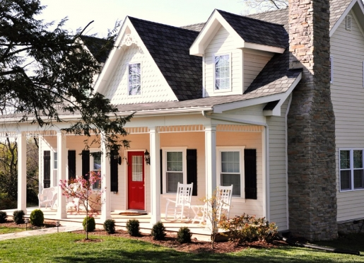Huntsman's Chase Guesthouse:  Large front pillared porch with swing and rocking chair seating