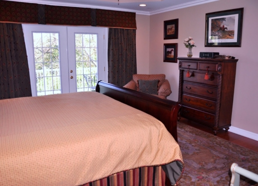 Luxury king master suite with tray ceiling, large walk-in closet, separate shower and whirlpool tub