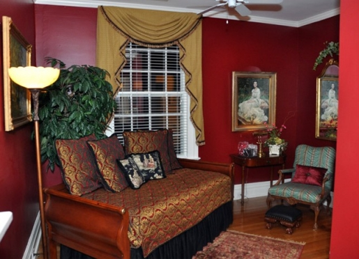 Has a large, private carpeted bedroom and lovely separate sitting room w/fireplaces, hardwood floor
