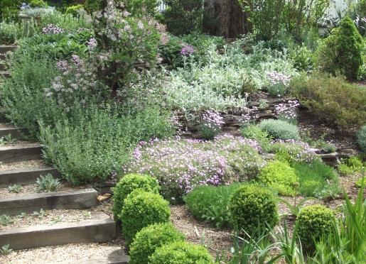 The Lower Garden features stacked-stone terraces with a wide variety of plants.