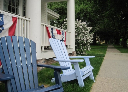 Adirondack chairs by the sweet-scented white lilac