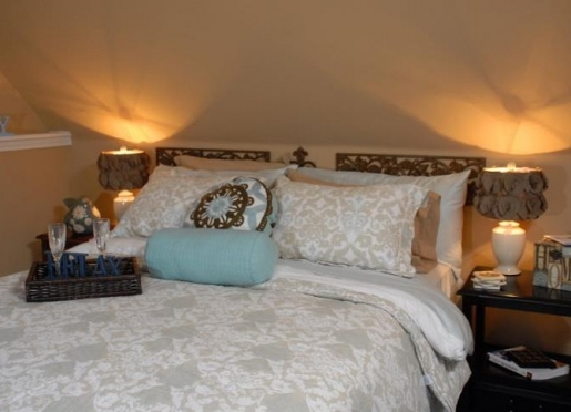 Sunny bedroom with queen sized bed, memory foam mattress & down comforter, extra pillows & blankets.