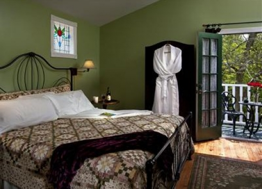 The stained glass windows beautifully flank the King size bed in Southern Charm.