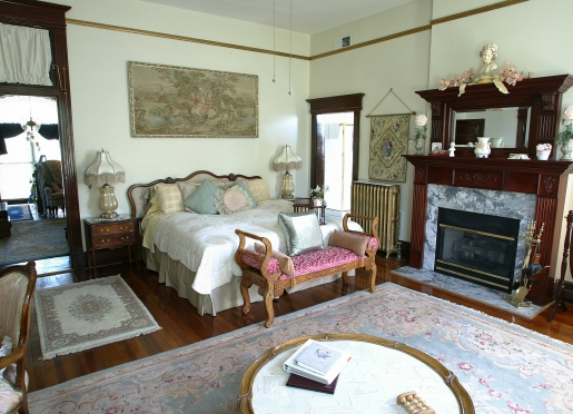 The Senator Beall Room with King bed, fireplace and heart-shaped whirlpool for two.