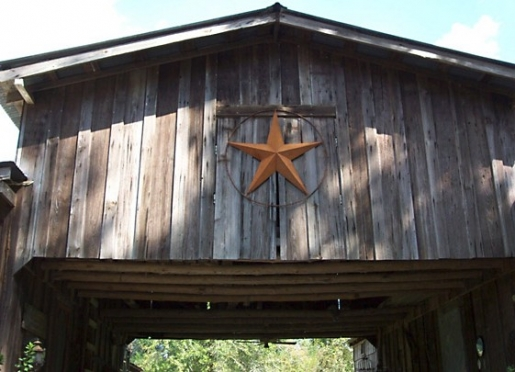 Barn Hideaway with Texas star on loft door