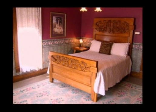 Our Guest Room has a charm all its own with delicate lace curtains and exquisite queen size bed