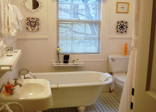 Newly renovated Rosamunde bathroom with walk in shower, antique tub, and custom tile.