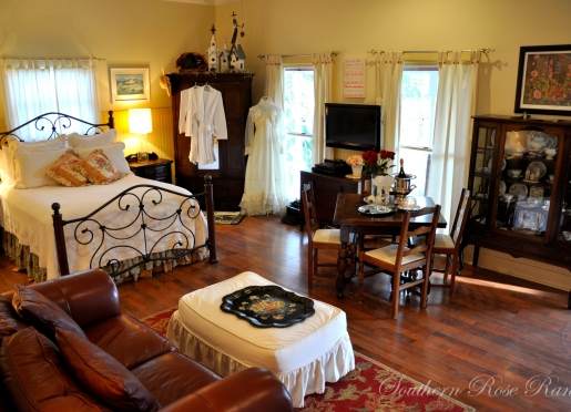 The Cottage decor Rose Suite with dining, leather seating, flatscreen TV, queen bed, separate shower