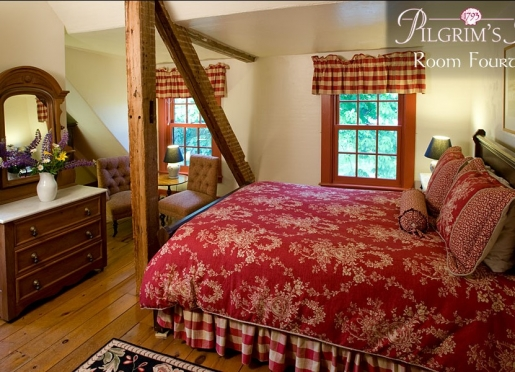 Room 14 on the third floor with queen bed and rustic decor