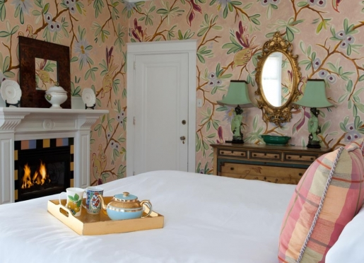 Pomegranate Inn guest rooms feature handpainted walls and gas fireplaces.