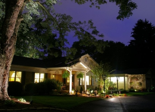 Front of Inn at night with landscape uplighting