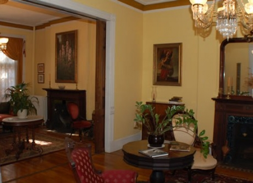 Two antique filled parlors for guests to relax in after a long day of sightseeing or business.