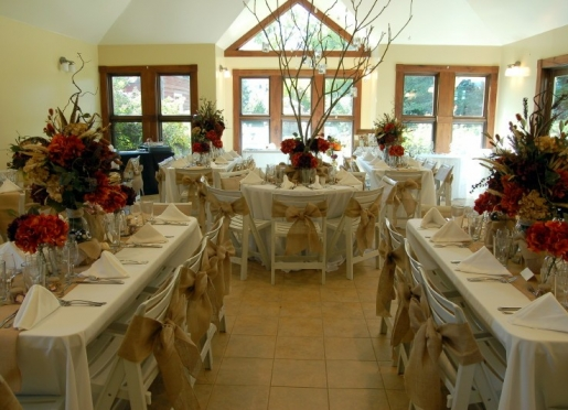 Banquet room set with floral designer's take on a sophisticated country wedding meal.