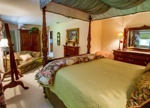 The Forest Hill Suite features a queen canopy bed, candle light fireplace. love seat & en suite bath