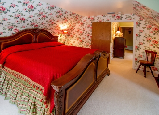 Mt. Mitchell Suite has mountain scenery from all three rooms, a king bed and candlelight fireplace.
