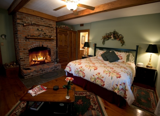 Bristol room...a wood workers delight! King bed and wood burning fireplace. Very romantic.