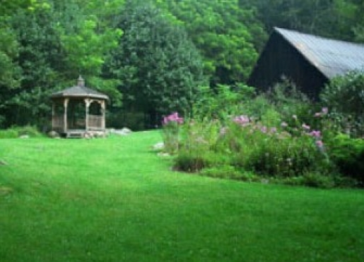 11 acres, 8 wooded, 3 with 14 perennial flower gardens, waterfall, stream, gazebo, and picnic area.