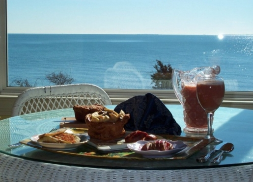Baileys gourmet breakfast is served on the oceanfront wraparound porch