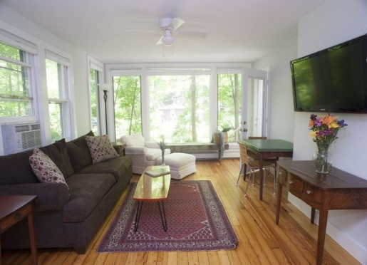 The sun-filled living room in Brookside Bungalow is perfect for relaxing and watching the stream.