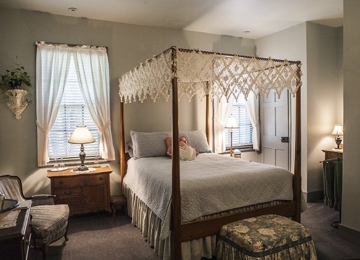 The Susan B is a quiet, cool, shaded, retreat with a canopy bed.